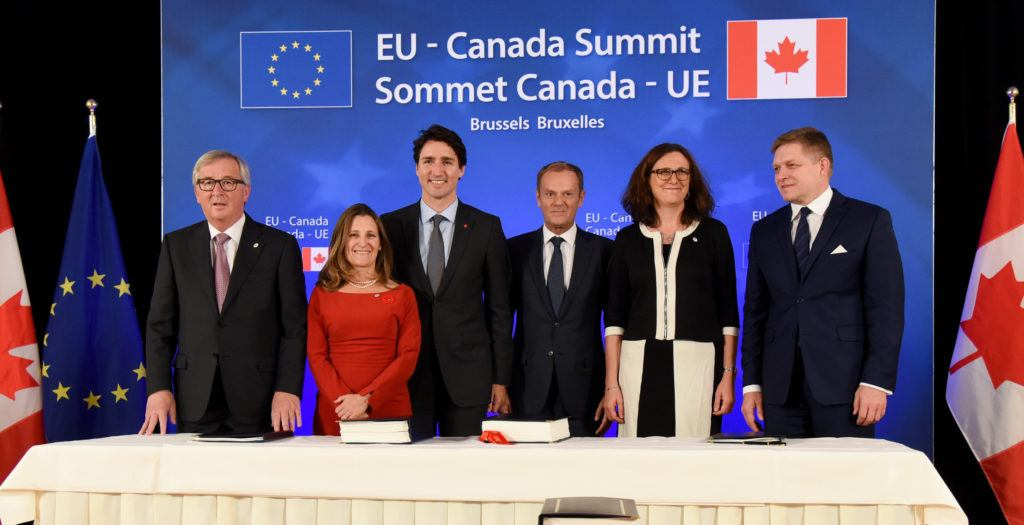 Group photo after the signing ceremony of the Strategic Partnership Agreement (SPA) and the Comprehensive Economic and Trade Agreement (CETA) between the EU and Canada: Jean-Claude Juncker, Chrystia Freeland, Justin Trudeau, Donald Tusk, Cecilia Malmström and Robert Fico (from left to right)